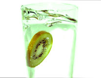Kiwi slice splash Royalty Free Stock Photo