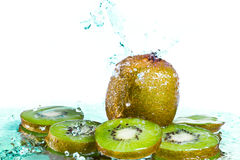 Kiwi with water splash Royalty Free Stock Images