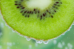 Kiwi water splash Stock Photo