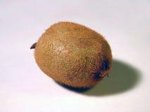 Kiwi on white. An isolated kiwi-fruit close-up royalty free stock photography
