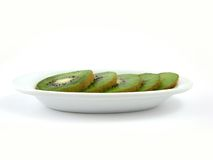 Kiwi on white plate. Kiwi slices on white plate Stock Photos