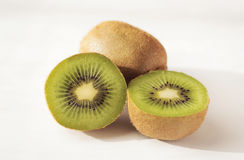 Kiwi. A whole kiwi and two halves on white background; close-up Royalty Free Stock Photos