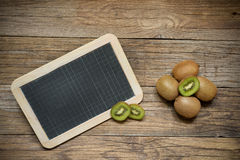 Kiwi on wood Stock Photography