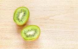 Kiwi on the wooden background: cross section Royalty Free Stock Photo