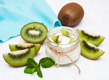 Kiwi yogurt. In glass on a old white wooden background Stock Photography