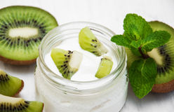 Kiwi yogurt. In glass on a old white wooden background Royalty Free Stock Photo
