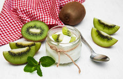 Kiwi yogurt. In glass on a old white wooden background Stock Photo