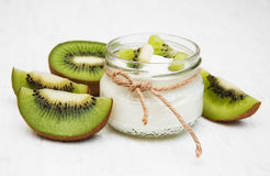 Kiwi yogurt. In glass on a old white wooden background Stock Image
