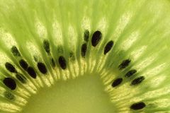 Kiwi1. Cut trough a ripe kiwi fruit - yummy royalty free stock photo