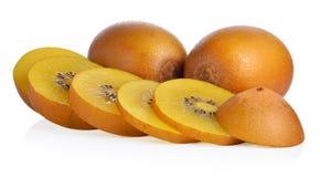 Kiwifruit dourado do todo e do corte no fundo branco fotografia de stock royalty free