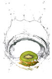 Kiwifruit in large splash Stock Photos