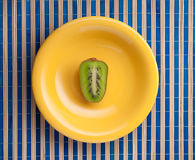 Kiwifruit on plate Royalty Free Stock Photos