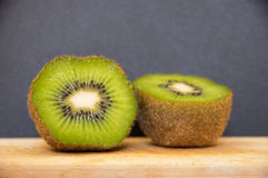 Kiwifruit. It`sA fruit with an oval shape. It is green on the inside with small black seeds that can be eaten. The kiwi has furry brown skin that is edible but royalty free stock photos