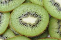 Kiwifruit Slice. Closeup of a bright green slice of kiwi fruit Royalty Free Stock Image