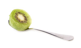 Kiwifruit in a teaspoon isolated Stock Images