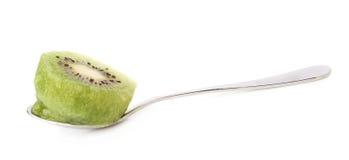 Kiwifruit in a teaspoon isolated Stock Photography