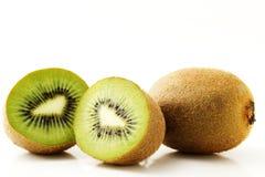 Kiwifruit and two half. One kiwifruit and two half kiwis isolated on white background stock photos