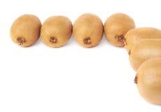 Kiwifruits aligned as corner isolated Royalty Free Stock Image