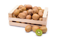 Kiwifruits in box. Ripe kiwifruits in wooden box. Chinese gooseberry Stock Photography
