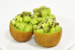 Kiwifruits into dice on white background. Taken in the studio of Tokyo Stock Photos
