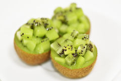 Kiwifruits into dice on white background. Taken in the studio of Tokyo Royalty Free Stock Image