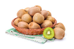 Kiwifruits in wicker plate. Ripe kiwifruits in wicker plate. Chinese gooseberry Royalty Free Stock Photography