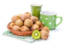 Kiwifruits in wicker plate. Ripe kiwifruits in wicker plate. Chinese gooseberry Stock Images