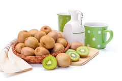 Kiwifruits in wicker plate. Ripe kiwifruits in wicker plate. Chinese gooseberry Stock Image