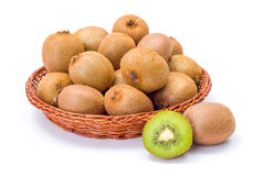 Kiwifruits in wicker plate. Ripe kiwifruits in wicker plate. Chinese gooseberry Royalty Free Stock Photo