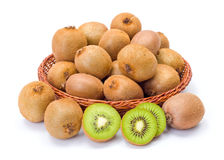 Kiwifruits in wicker plate. Ripe kiwifruits in wicker plate. Chinese gooseberry Stock Photo