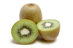 Kiwis. Sliced Kiwis isolated on white background Royalty Free Stock Photos