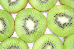 Kiwis. Slices of kiwis, close up on white background stock photo