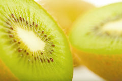 Kiwis. Close-up studio shot of some Kiwis (two in halfs). Isolated. White background Royalty Free Stock Photo