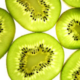 Kiwis. Close-up studio shot of back lit slices of Kiwis. Isolated. White background stock photography