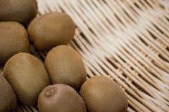 Kiwis. In a wicker basket stock image