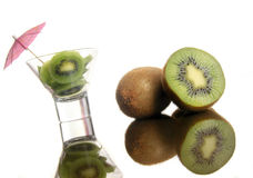 Kiwis. Kiwi is standing in a cup with pink umbrella detail Royalty Free Stock Photography