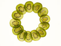 Kiwis. Sliced green kiwis in backlight stock images