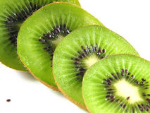 Kiwis also begin small :-). Sliced kiwis and a seed Royalty Free Stock Images