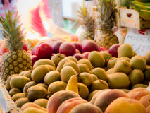 Kiwis and ananas at the open market Stock Photo