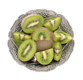 Kiwis. In antique metal bowls a white background stock photography