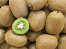 Kiwis background. A pile of beautiful kiwis on a counter stock images