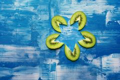 Kiwis in blue background textured stock photography