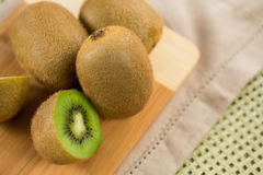 Kiwis on chopping board Stock Images