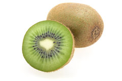 Kiwis coupés en tranches et entiers photos stock