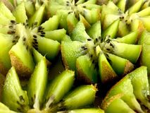 Kiwi flowers. Kiwis cut into flower patterns royalty free stock photography