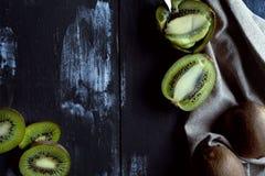 Kiwis in dark background textured Royalty Free Stock Image