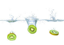 Kiwis falling into water with splashes Royalty Free Stock Photography