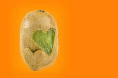 Kiwis with heart shapes carved into its skin Royalty Free Stock Images