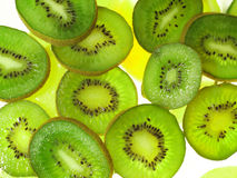 Kiwis on ice. Kiwis on abstract ice background royalty free stock photos