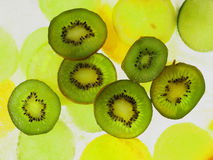 Kiwis on ice. Kiwis on abstract ice background stock image
